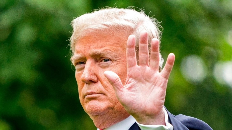 President Donald Trump waves to members of the media before boarding Marine One on the South Lawn of the White House in Washington.