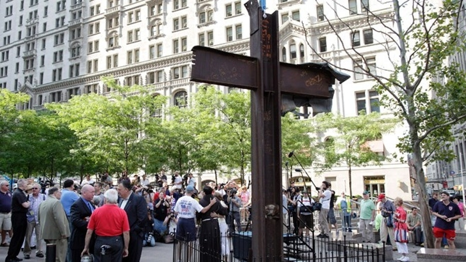 FILE: July 23, 2011: The World Trade Center Cross waits to be blessed by  a Franciscan priest, New York, N.Y.