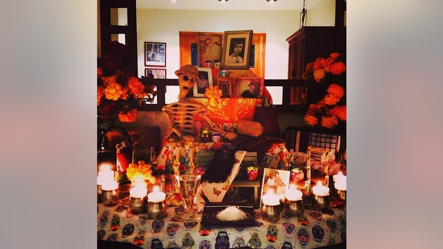 "QUERETARO, MX. An altar in the middle of a family's home is dedicated to their loved ones who have passed away. The objects placed on the altar are known as ""ofrendas"" or ""offerings."" (Photo by Monica Serrano)"