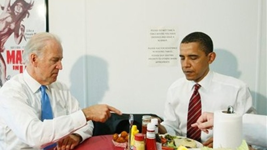 Tuesday: President Obama and Vice President Biden are served their burgers at lunch at Ray's Hell Burger in Arlington, Va. (AP Photo)
