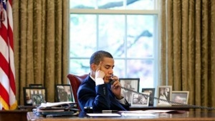 May 6,2009. President Obama talks to Chinese President Hu on the phone. White House Photo