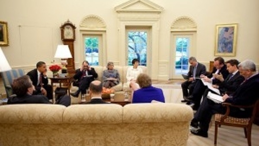 May 5, 2009. President Obama receives his daily economic briefing in the Oval Office. White House Photo