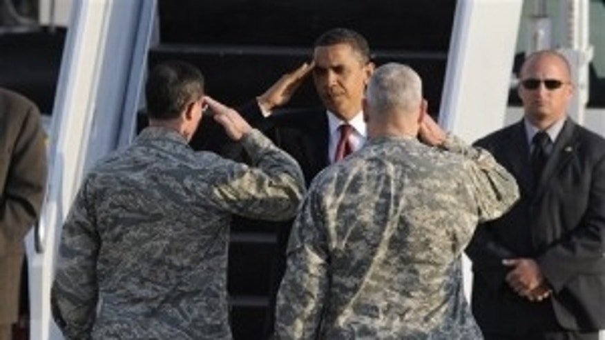 President Barack Obama saluts to Army General Carter Ham, right, and Airforce General Mark Rogers as he leaves the US Airbase in Ramstein, Germany, Friday, June 5, 2009. Obama  en route from Egypt to France visited Dresden, the former Nazi concentration camp Buchenwald and the US regional medical center in Landstuhl during his stopover in Germany. (AP Photo)