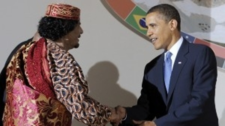 Libyan leader Muammar Gaddafi, left, shakes hands with U.S. President Barack Obama during a dinner at the G8 summit in L'Aquila, Italy on Thursday, July 9, 2009. (AP Photo/Michael Gottschalk, Pool)