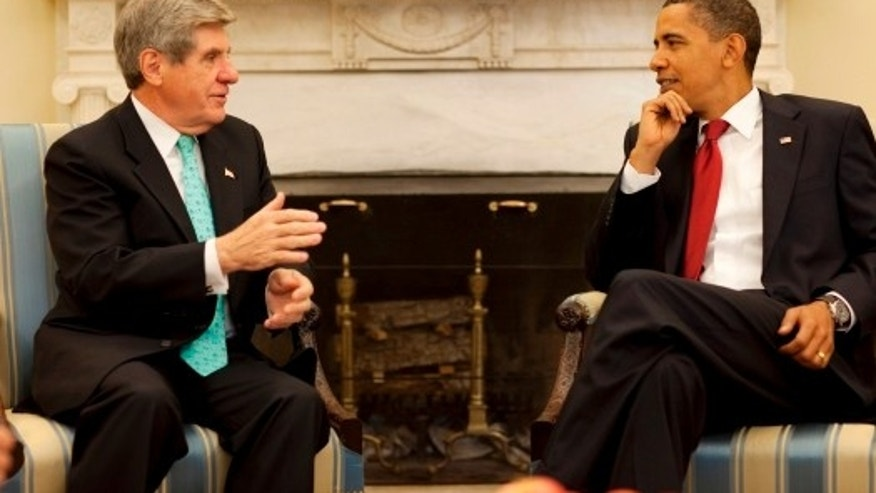 President Barack Obama meets with Senator Ben Nelson of Nebraska to discuss health care reform