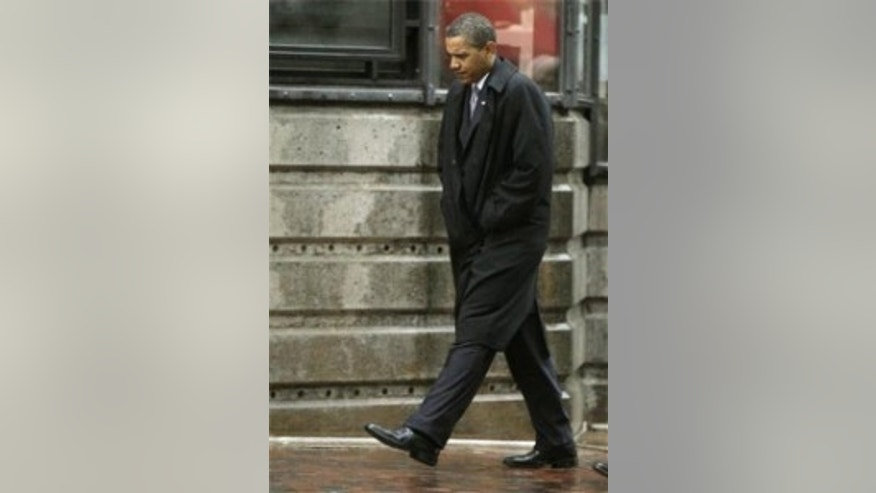 President Obama walks back to his hotel after a private meeting with Vicki Kennedy (AP Photo)