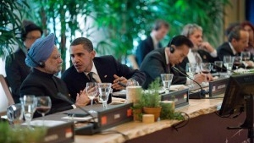 President Obama talks with Indian Prime Minister Singh during a working dinner at the G20 Summit in Pittsburgh, PA.  Sept. 24, 2009. (WH Photo)