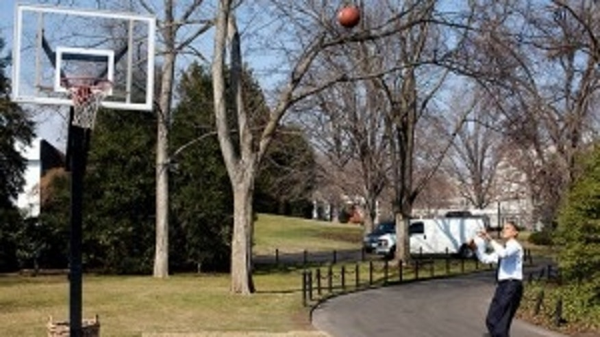 President Barack Obama shoots hoops on the White House South Lawn basketball court 3/6/09 (WH Photo)