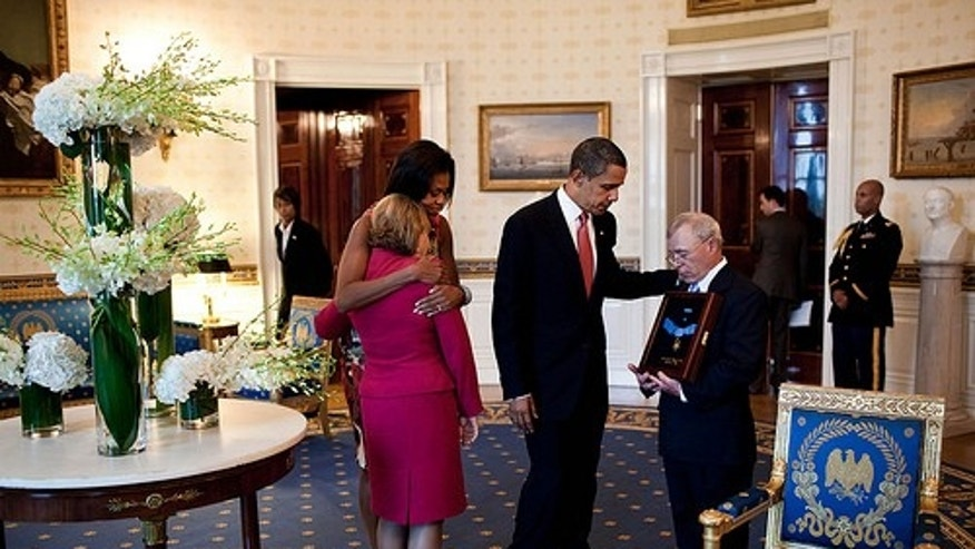 President Barack Obama and First Lady Michelle Obama console Paul and Janet Monti, parents of Army Sgt. 1st. Class Jared C. Monti in the Blue Room following a Medal of Honor ceremony in the East Room of the White House on Sept. 17, 2009.