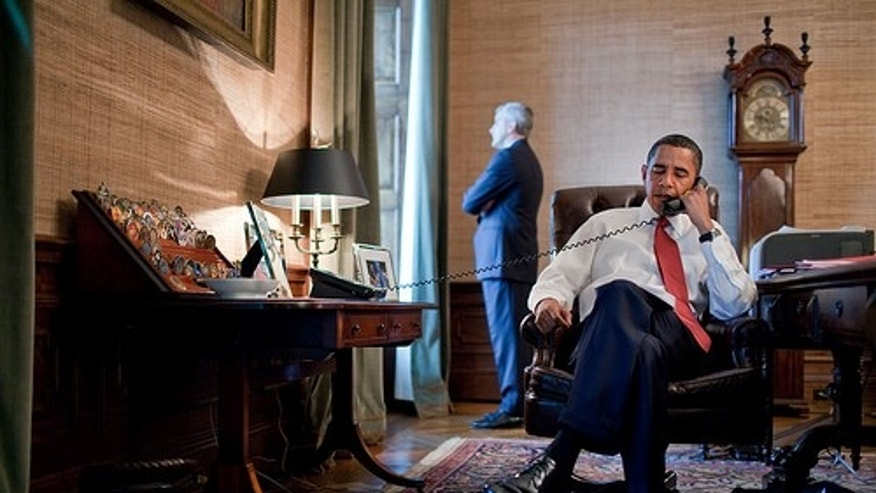 President Barack Obama talks with Prime Minister Donald Tuck of Poland, in the President's office in the private residence of the White House, Sept. 17, 2009. NSC Chief of Staff Denis McDonough looks out the window during the call.