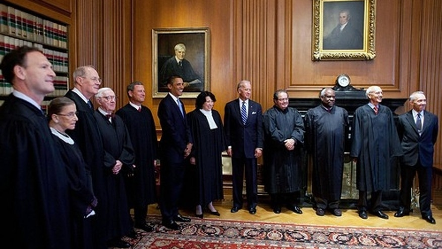 President Barack Obama and Vice President Joe Biden pose for a photo with Supreme Court Justices prior to the investiture ceremony for Justice Sonia Sotomayor, at the Supreme Court in Washington, D.C., Sept. 8, 2009.