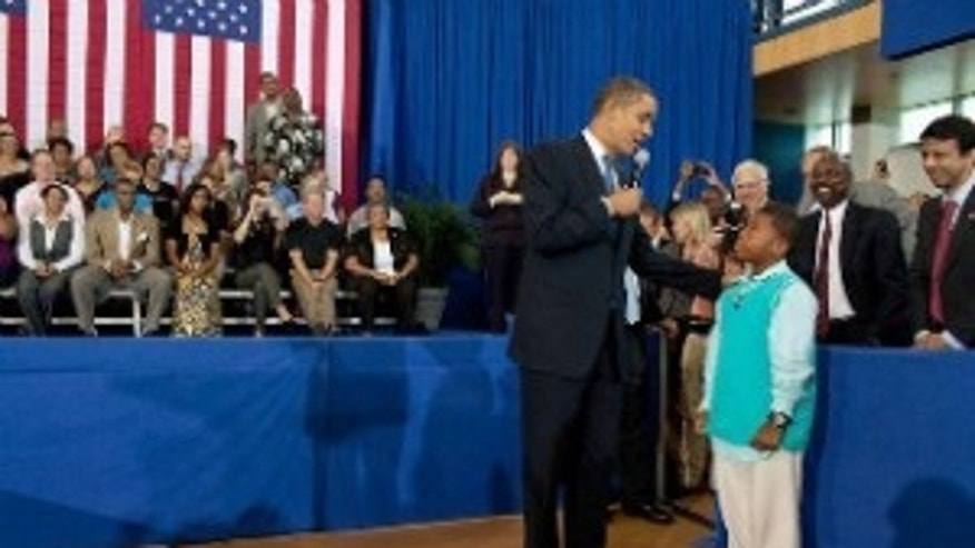 President Obama answers a question from Tyren Scott at his town hall in New Orleans. (WH Photo)