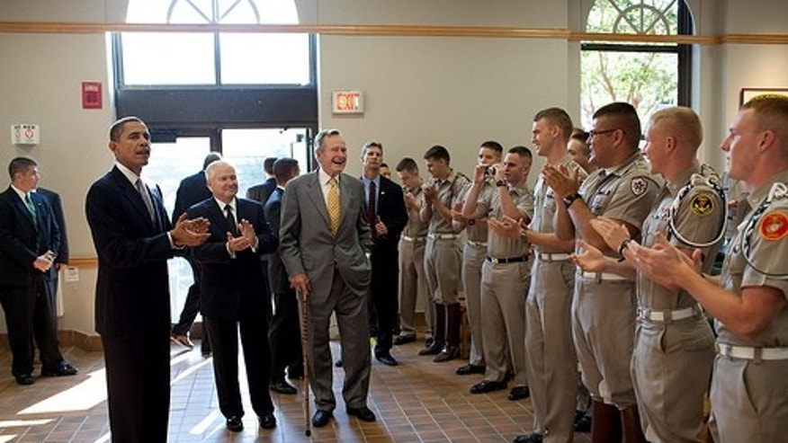 President Barack Obama, former President George H. W. Bush and Defense Secretary Robert Gates greet Marine Corps cadets in the Marine Corps Mess Hall at Texas A&M University, in College Station, Texas, Oct. 16, 2009 (Official White House Photo by Pete Souza)