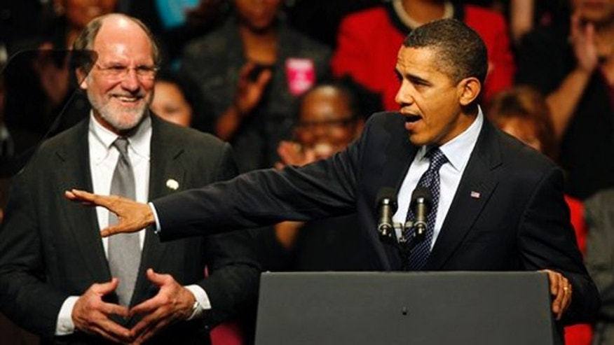 Gov. Jon Corzine listens to President Obama at a campaign rally Nov. 1 in Camden, N.J. (AP Photo)