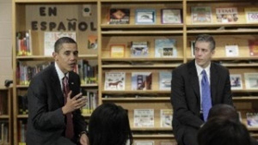 President Obama and Education Secretary Arne Duncan speak to students at Wright Middle School in Madison, WI (AP Photo)