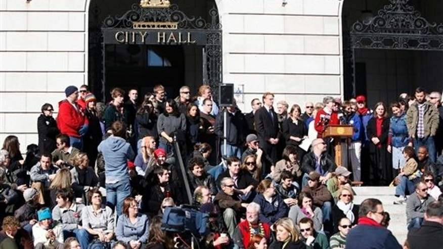 Supporters of same-sex marriage meet on the steps of City Hall, in Portland, Maine, on Wednesday, Nov. 4, 2009, a day after voters rejected the gay marriage law that was passed last May.  (AP)