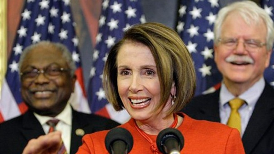 Nov. 7: Speaker Nancy Pelosi is joined by Majority Whip James Clyburn, and Rep. George Miller, D-Calif. during a press conference at the U.S. Capitol after the passage in the house of the health care reform bill. (AP)