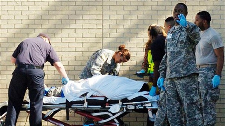 Thursday, Nov. 6, 2009: Emergency personnel transport an unidentified soldier from the Soldier Readiness Center following a shooting at Fort Hood, Texas.