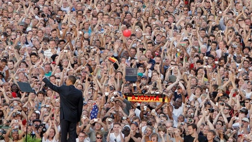 In this July 24, 2008, photo, then-Sen. Barack Obama is seen greeting the crowd in Berlin. (AP Photo)