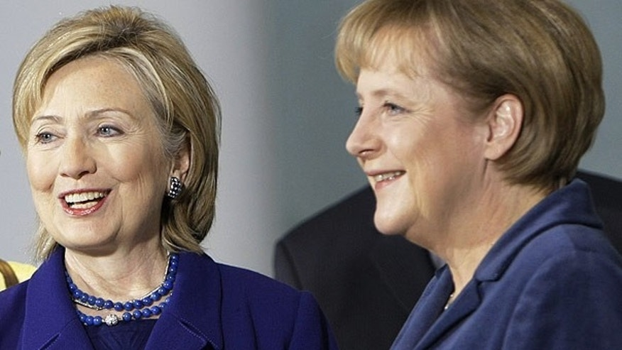 Nov. 9: German Chancellor Angela Merkel, right, welcomes Secretary of State Hillary Clinton in Berlin, Germany. (AP)