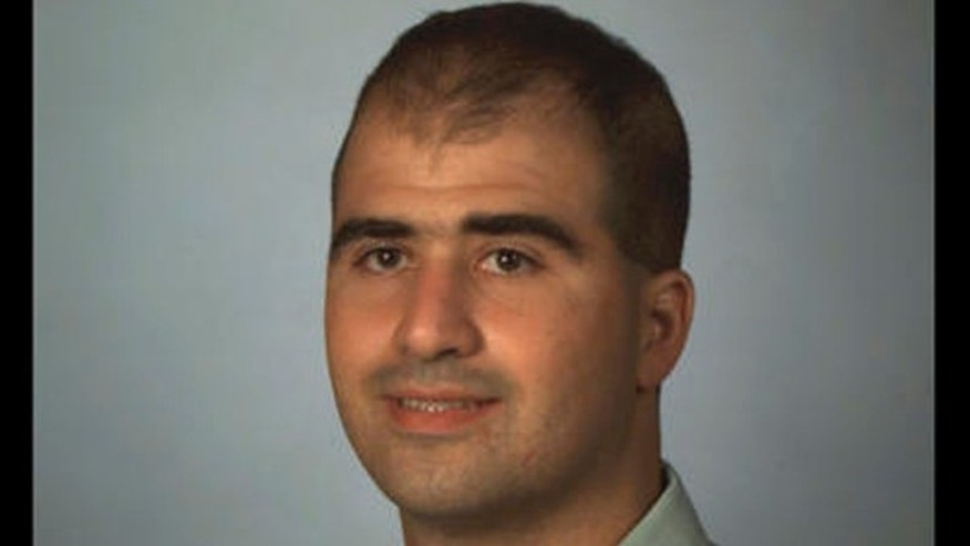 2000 file photo of Uniformed Services University of the Health Sciences medical student Nidal Malik Hasan. (AP Photo)
