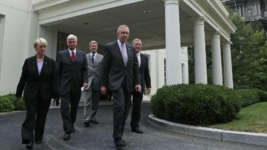 Democratic Senators walk out of the West Wing after meeting with President Barack Obama about healthcare legislation at the White House in Washington, August 4, 2009. (Reuters)
