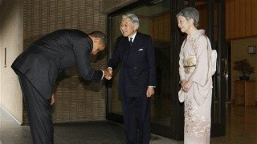 President Obama bows as he is greeted by Japanese Emperor Akihito and Empress Michiko at the Imperial Palace in Tokyo. (AP Photo)