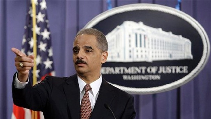 FILE: Attorney General Eric Holder gestures during a news conference at the Justice Department in Washington, D.C., on Nov. 13, 2009. (AP Photo)