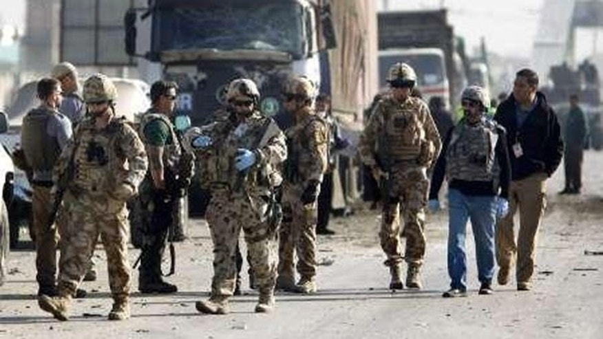 NATO-led troops are seen near a blast site after a suicide bomb attack in Kabul Nov. 13. (Reuters Photo)