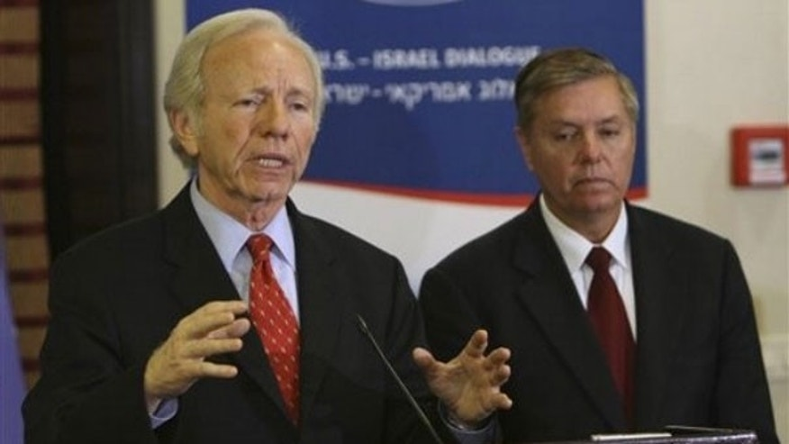 Nov. 16, 2009: Sen. Joe Lieberman, I-Conn., talks as Sen. Lindsey Graham, R-S.C., listens during a press conference at the Saban Forum in Jerusalem (AP).