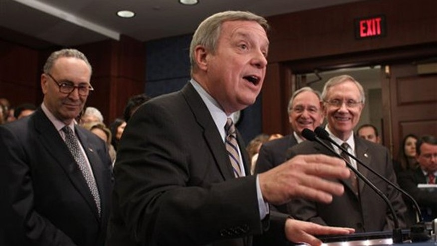 Senate Majority Whip Richard Durbin speaks during a health care reform news conference on Capitol Hill Nov. 19. (AP Photo)