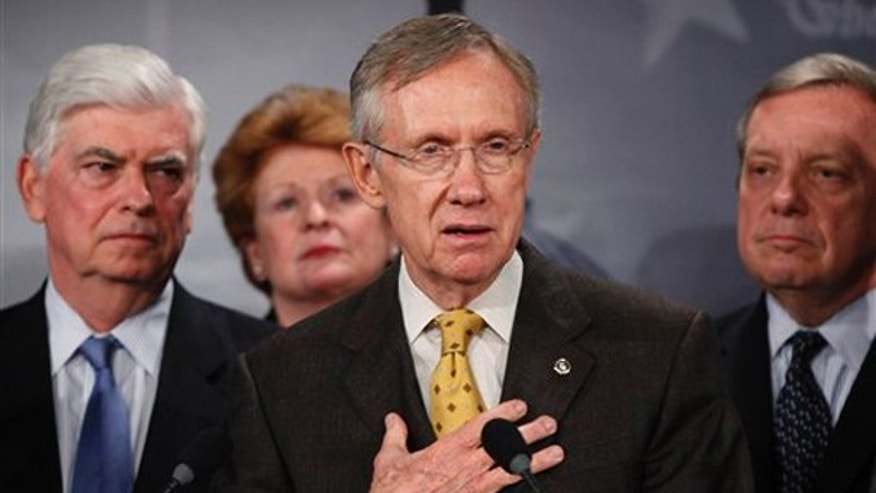 Senate Majority Leader Harry Reid, D-Nev., second right, with Sens. Chris Dodd, D-Conn., left, Debbie Stabenow, D-Mich., second left, and Dick Durbin, D-Ill., right, speaks to the media about the Democratic health care bill on Capitol Hill Nov. 18. (AP Photo)
