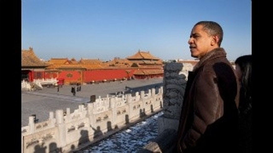 President Barack Obama looks out over the Forbidden City in Beijing, China. November 17, 2009. (Official White House Photo by Pete Souza)