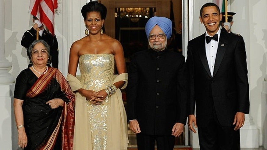 Nov. 24: President Obama and first lady Michelle  welcome India's Prime Minister Manmohan Singh and his wife Gursharan Kaur to the State Dinner at the North Portico of the White House. (AP)