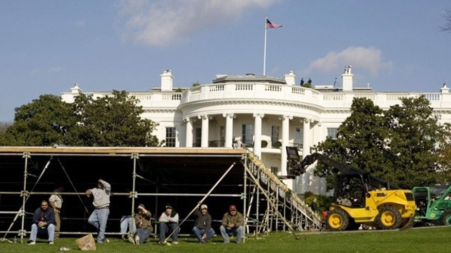 Workers build the floor to a tent on the South Lawn of the White House for Obama's first state dinner. (Reuters)
