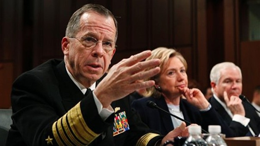 Joint Chiefs Chairman Adm. Michael Mullen, left, testifies on Capitol Hill Dec. 3, as Secretary of State Hillary Clinton and Defense Secretary Robert Gates look on. (AP Photo)