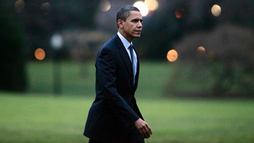 President Obama walks on the South Lawn of the White House in Washington, Friday, Dec. 4, 2009, after he returned from a trip to Allentown, Pa. (AP)