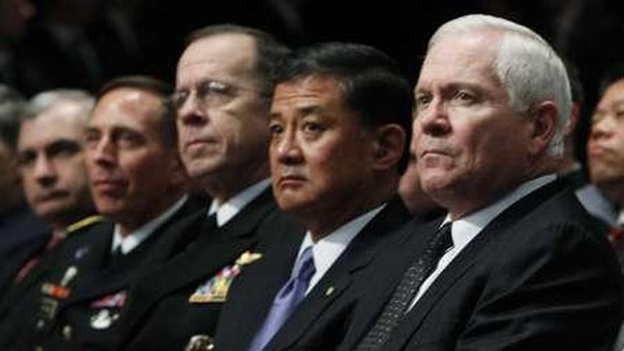 Defense Secretary Robert Gates, right, sits with U.S. military leaders before President Obama addresses cadets at West Point, N.Y., on Dec. 1. (Reuters Photo)