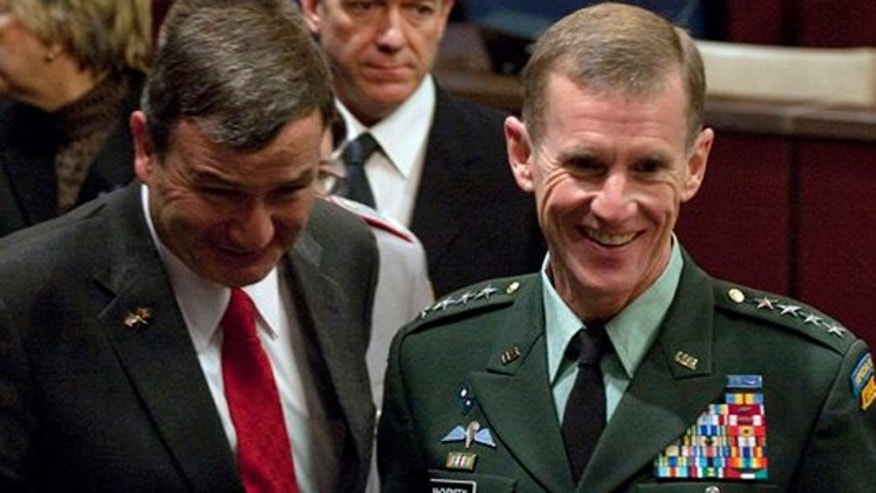Ambassador to Afghanistan Karl Eikenberry, left, and Army Gen. Stanley McChrystal before giving testimony assessing the results in Afghanistan to the House Armed Services Committee, Tuesday, Dec. 8, 2009.