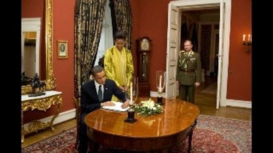 President and First Lady sign guest book at the Royal Palace in Oslo, Norway. White House Photo.