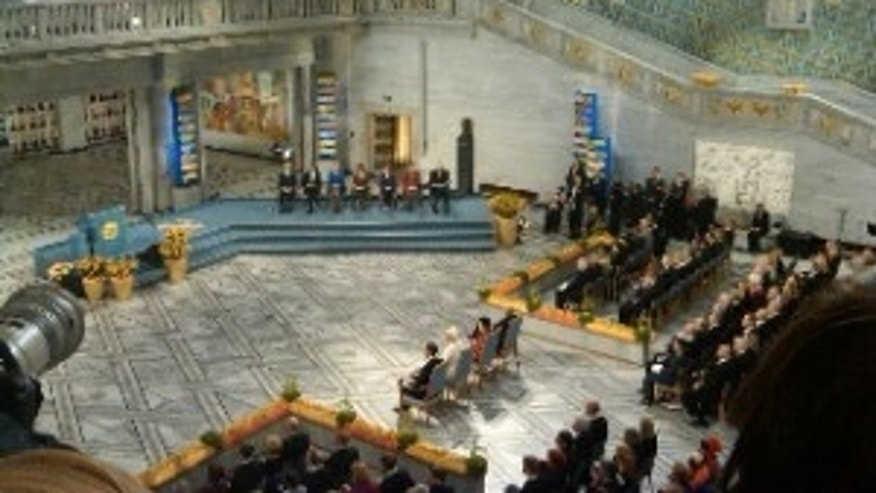 President Obama, second on the left, at the Nobel Prize Ceremony (Photo Courtesy of Travel Pool/Anne McGinn)
