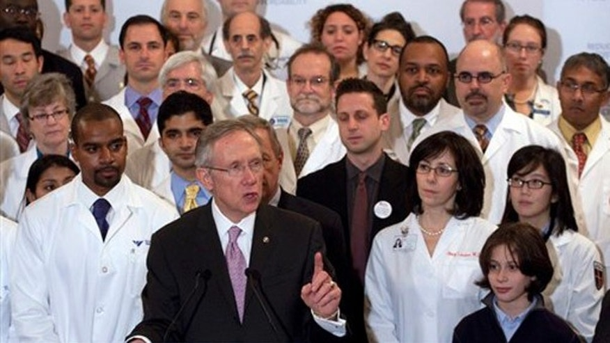 Senate Majority Leader Harry Reid, D-Nev., surrounded with doctors, speaks at a health care news conference on Capitol Hill in Washington, Thursday, Dec. 10, 2009. (AP)