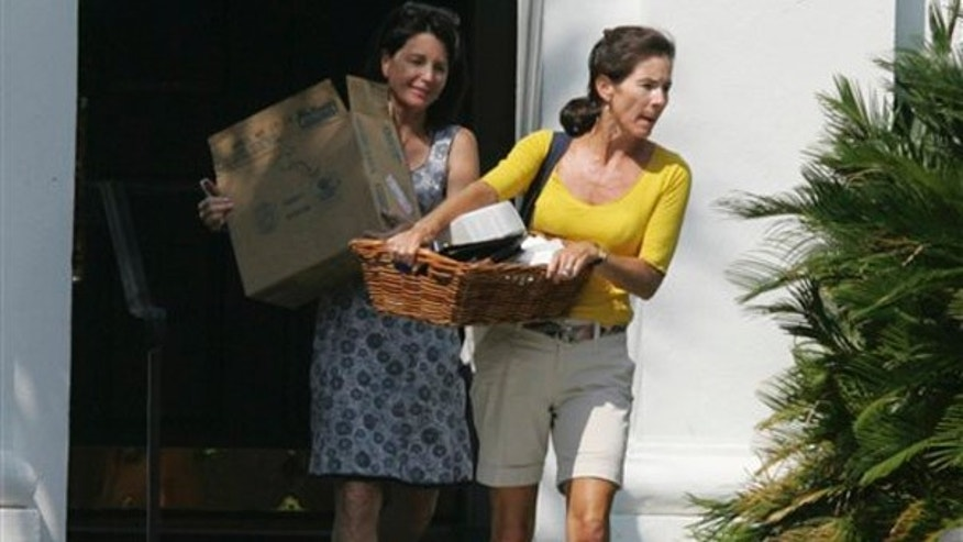 In a Friday, Aug. 7, 2009 file photo, South Carolina first lady Jenny Sanford, right, carries out her belongings from the Governor's Mansion with help from an unidentified friend, in Columbia, S.C.(AP)