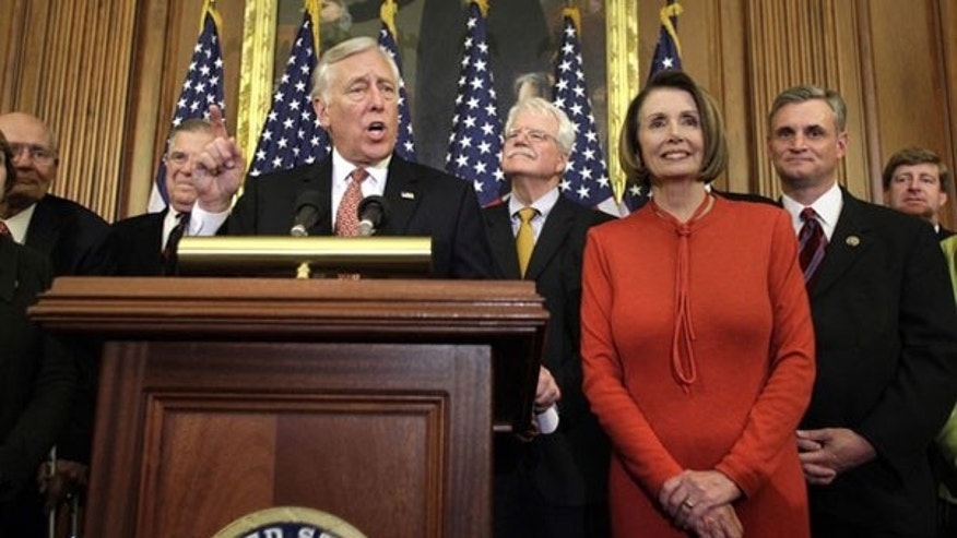 House Majority Leader Steny Hoyer speaks next to Speaker Nancy Pelosi at a news conference on Capitol Hill Nov. 7. (Reuters Photo)