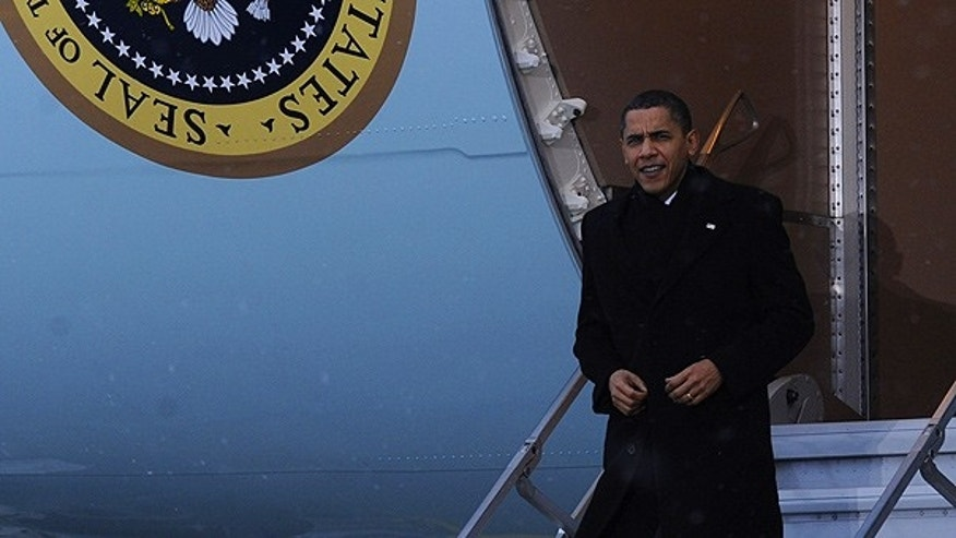 Dec. 18: President Obama walks off of Air Force One and into the snow at Copenhagen Airport. (AP)
