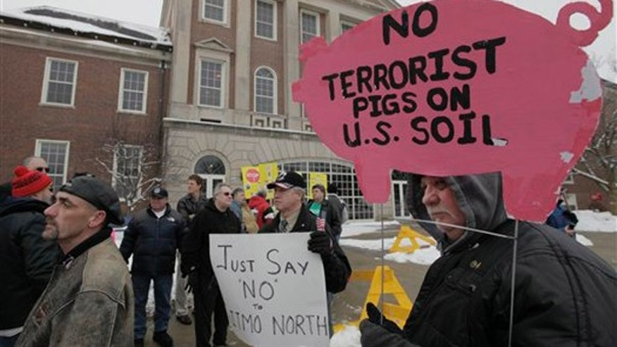 Protesters gather outside a Illinois legislative hearing Tuesday, Dec. 22, 2009 in Sterling, Ill. regarding an Obama administration decision to buy the underused Thomson Correctional Center in Thomson, Ill. to house up to 100 Guantanamo Bay detainees. (AP)