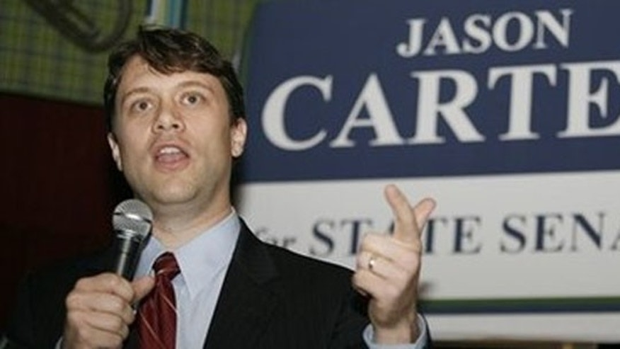 Dec. 9: Atlanta attorney Jason Carter, grandson of former President Jimmy Carter, announces his candidacy for the Georgia state Senate at a restaurant in Decatur, Ga. (AP Photos)