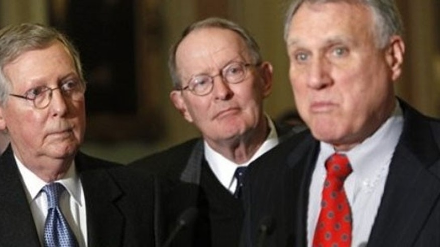 Tuesday: Senate Minority Leader Mitch McConnell of Ky., left, and Sen. Lamar Alexander, R-Tenn., center, listen to Senate Minority Whip Jon Kyl of Ariz., have tried unsuccessfully many different ways to stop the health insurance bill. (AP Photo)
