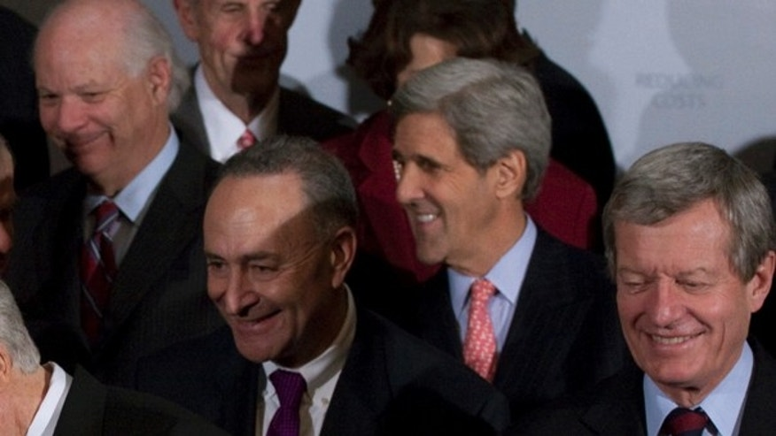 Wednesday: Sen. John Kerry shared a laugh with other Senate Democrats during a health care news conference. (AP Photo)