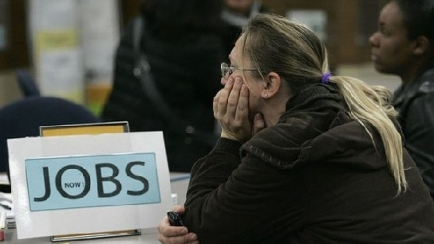 Nov. 20: A worker awaits the start of seminars for job seekers at an employment center in San Francisco, Calif., where unemployment in November was 12.3 percent. The national unemployment rate peaked at 10.2 percent in October (Reuters).
